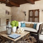 Fireplace Stone Classic Decorated Doors Wall Light White Couch Stripes Chair Greenery Ceiling Fan