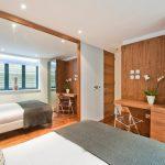 floor to ceiling mirror bed pillows hardwood floor clear chair flowers ceiling lights modern bedroom