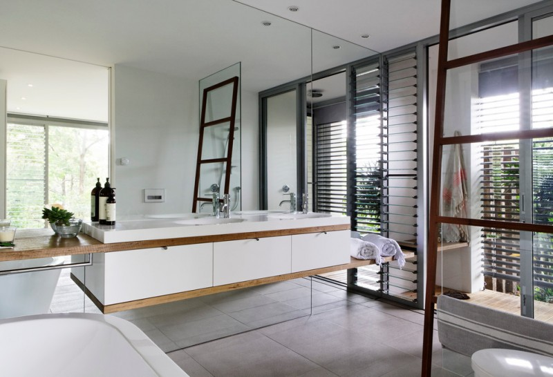 floor to ceiling mirror faucets sinks toilet towels decorative plant contemporary bathroom