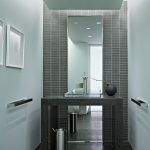 floor to ceiling mirror trash bin towel racks faucet ceiling lights modern powder room