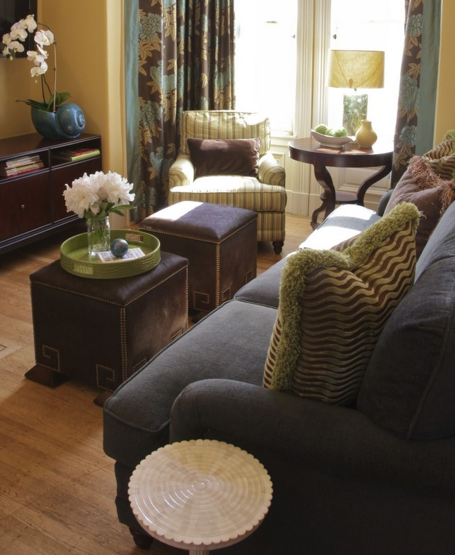 furniture for a small living room ottomans sofa small tables pillows armchair wood floor window curtains eclectic room