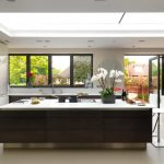garden windows for kitchen flat panel cabinets island stools glass sheet backsplash quartzite countertops ceramic floors undermount sink ceiling lights contemporary design