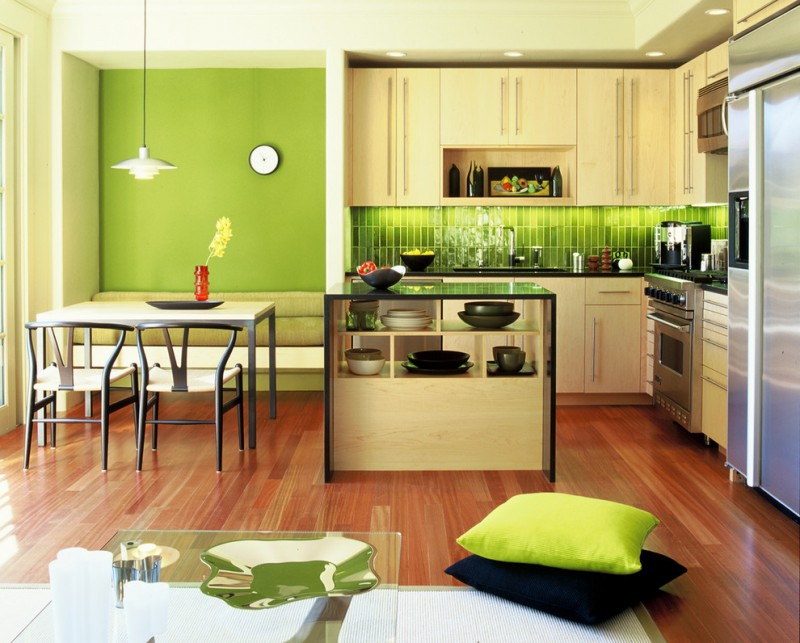 good colors for kitchens flat panel cabinets green backsplash ceiling lights island countertops undermount sink stainless steel appliances dining table chairs hardwood floors modern design