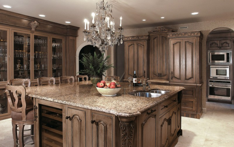 good colors for kitchens glass front cabinet granite countertops island tall back chairs double bowl sink ceiling lights chandelier white floors stainless steel appliances victorian style