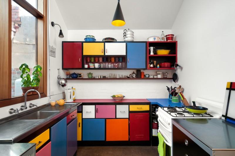 good colors for kitchens integrated sink flat panel cabinets white appliances laminate countertops pendant light fixture oversized window backsplash eclectic design