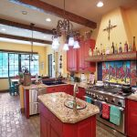 good colors for kitchens raised panel cabinets granite countertop undermount sink stainless steel appliances brick floors column ceiling multicolored backsplash wall decorations southwestern style