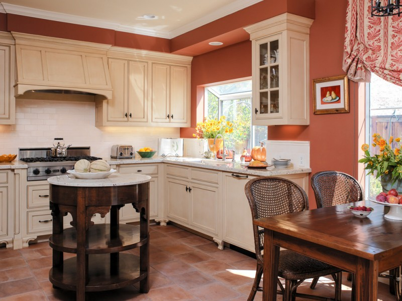 good colors for kitchens raised panel cabinets subway tile backsplash granite countertop round island wood table rattan chairs undermount sink ceiling light mediterranean design