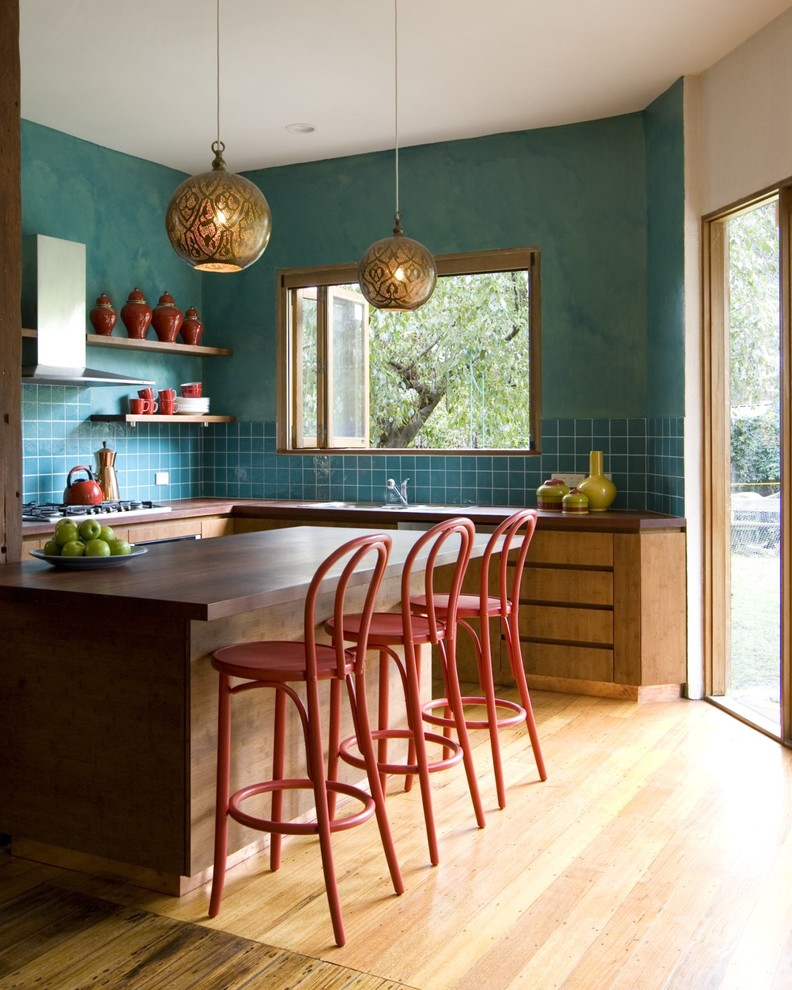 good colors for kitchens wood countertop ceramic backsplash flat panel cabinets light hardwood floors ethnic pendants undermount sink red stools hanging shelves transitional design