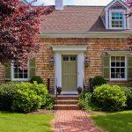 Green Wooden Colonial Front Door With Golden Door Knocker, Dark Glass On Top Of The Door
