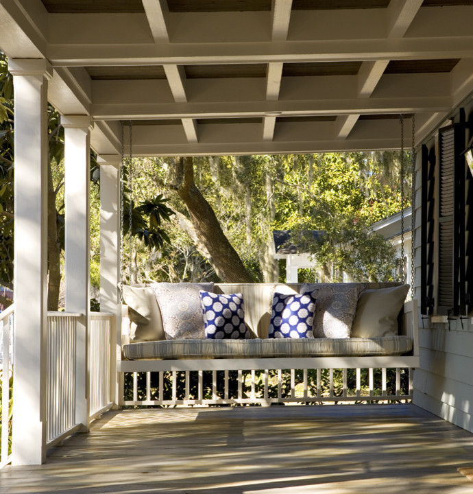 hanging chair ranch style porch furniture front porch swing polka pillow