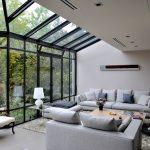 Hopper Window Grey Couch Beautiful Chandelier Fluffy Rug Armchair Half Glass Ceiling Grey Footstool
