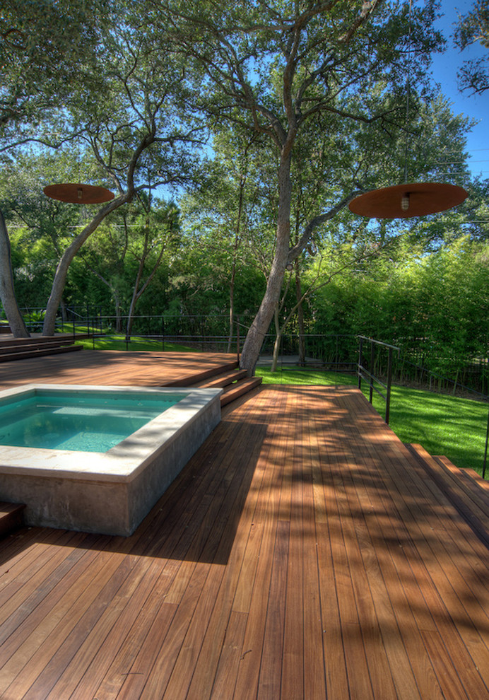 hot tub in a wooden lpe deck with yellow tiles
