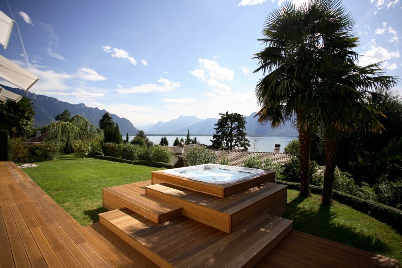 hot tub with raised on platform with zigzag stairs