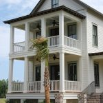 House Plans On Pilings A Frame Home Black Ceiling Fans For The Deck White Wooden Railings Palm Tree