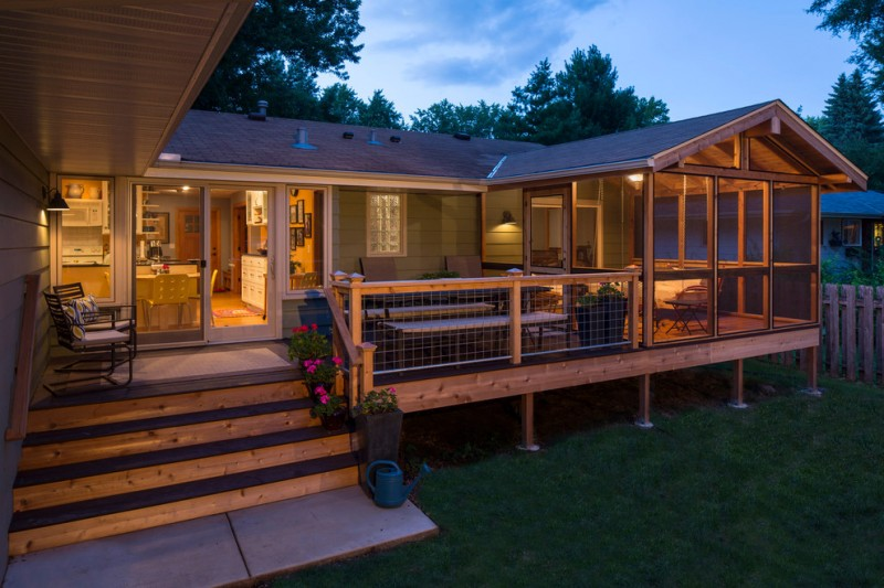 house plans on pilings traditional deck screened home nice iron and wood railing black iron armchairs with colorful pillow