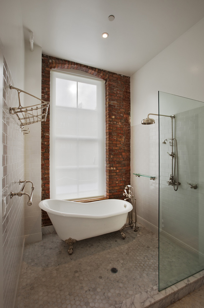 jacuzzi tub shower combo brick wall glass claw foot bathtub racks glass shelf ceiling light industrial bathroom