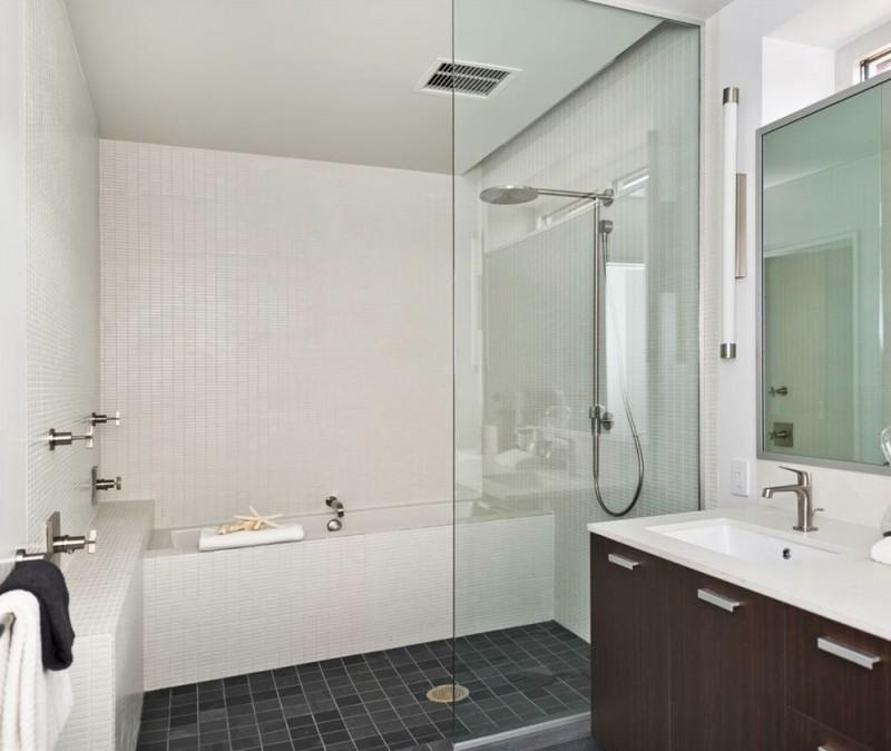 jacuzzi tub shower combo dark floor towels rack faucets cool modern lamp bathroom