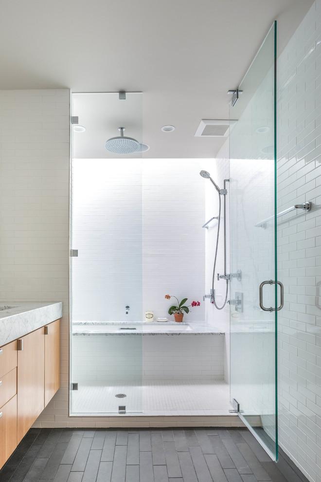 jacuzzi tub shower combo flowers dark floor glass door towel rack contemporary bathroom