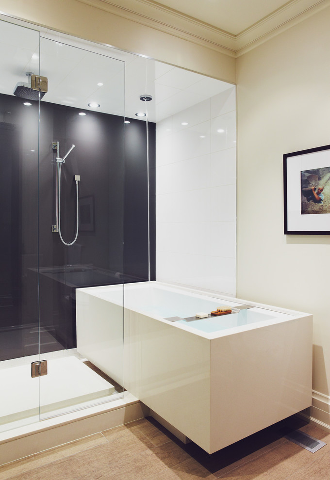 jacuzzi tub shower combo light coloured floor glass door ceiling lights wall decor contemporary bathroom