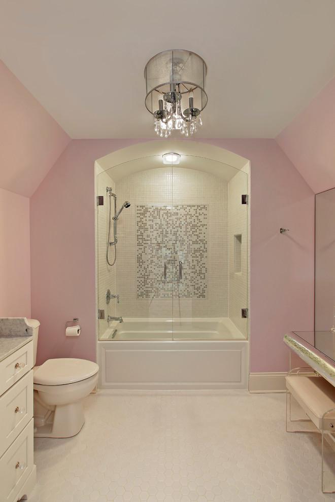 jacuzzi tub shower combo pink walls chandelier toilet drawers lamp glass doors traditional bathroom