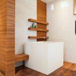 Japanese Soaking Tub Small Square Tub Fireplace In Bathroom Wood Paneling Floating Shelves Wood Flooring