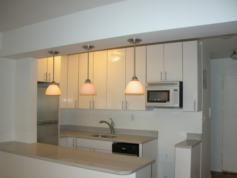 kitchen remodeling nyc wall cabinets pendant lights sink faucet contemporary style kitchen