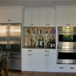 kitchen remodeling nyc wood floor chairs table fridge wall cabinets shelf traditional style room