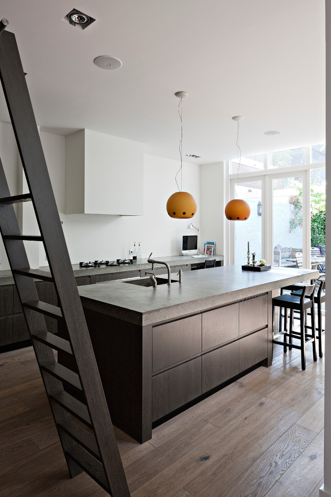 kitchen remodelingnyc wood floor ladder tall chairs faucet sink concrete countertop modern room