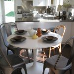 Kitchen Table Sets Ikea Chairs White Round Top Table Dark Floor Window Wall Cabinets Stove Faucet Eclectic Dining Room