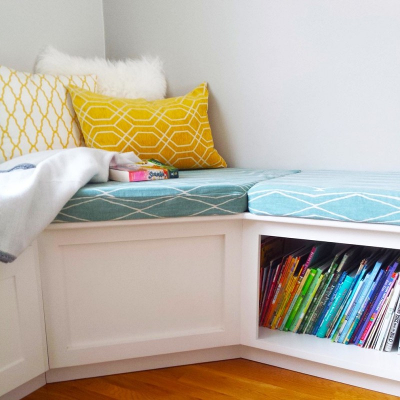 l shaped bench with storage blue cushion book storage yellow patterned pillow