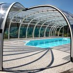 Large And Full Covered Pool Enclosure Made Of Glass Panels And Aluminum Mid Size Swimming Pool Small Stones Floors