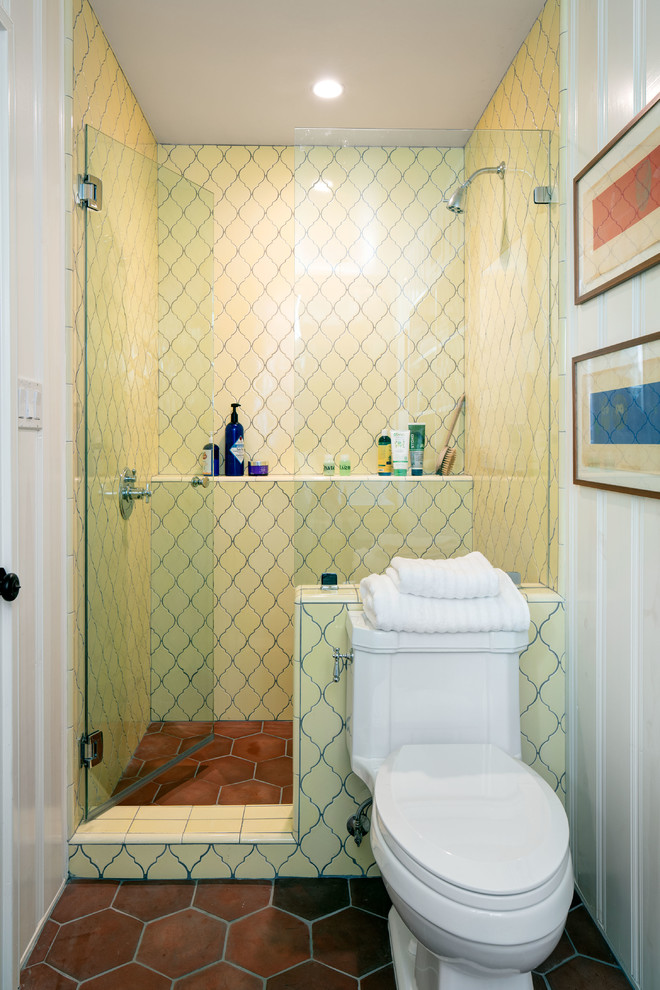 light yellow ceramic tiles for walls simple vertical stripes for walls hexagonal shaped ceramic tiles for floors white toilet small walk in shower space with glass door