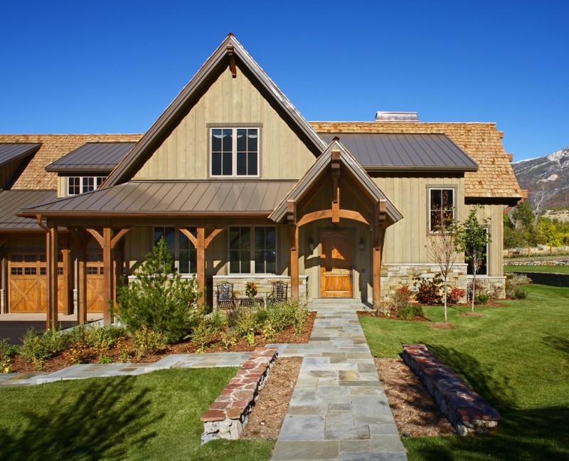 luxury ranch house plans beige walls stone pavers wood doors white frame windows pool garden rustic design