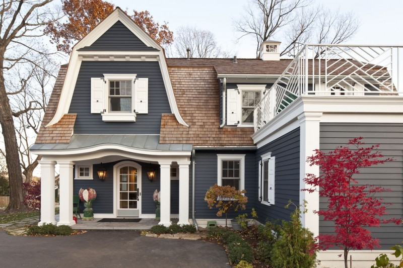 luxury ranch house plans gable roof grey walls column glass door white pillars stone pavers traditional design