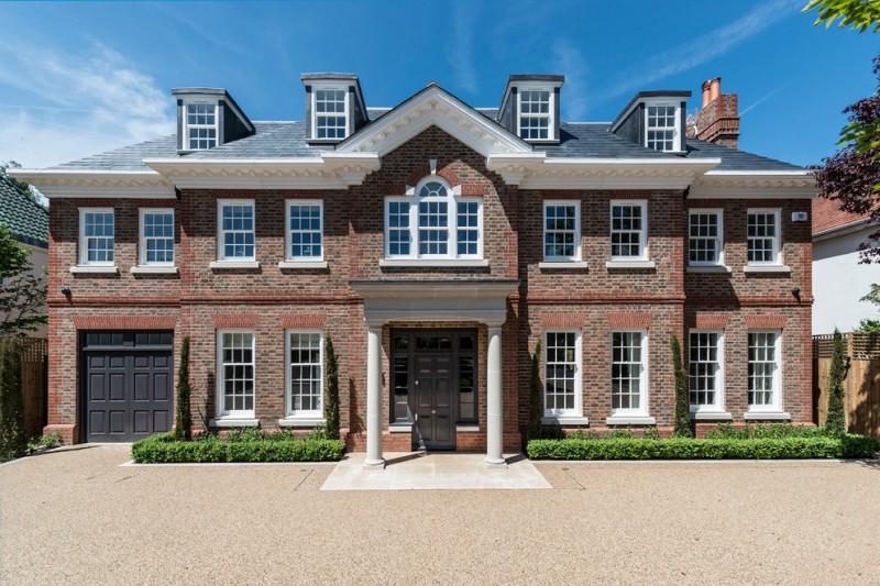 luxury ranch house plans hip roof brick walls white pillars brown doors column windows stone pavers transitional design