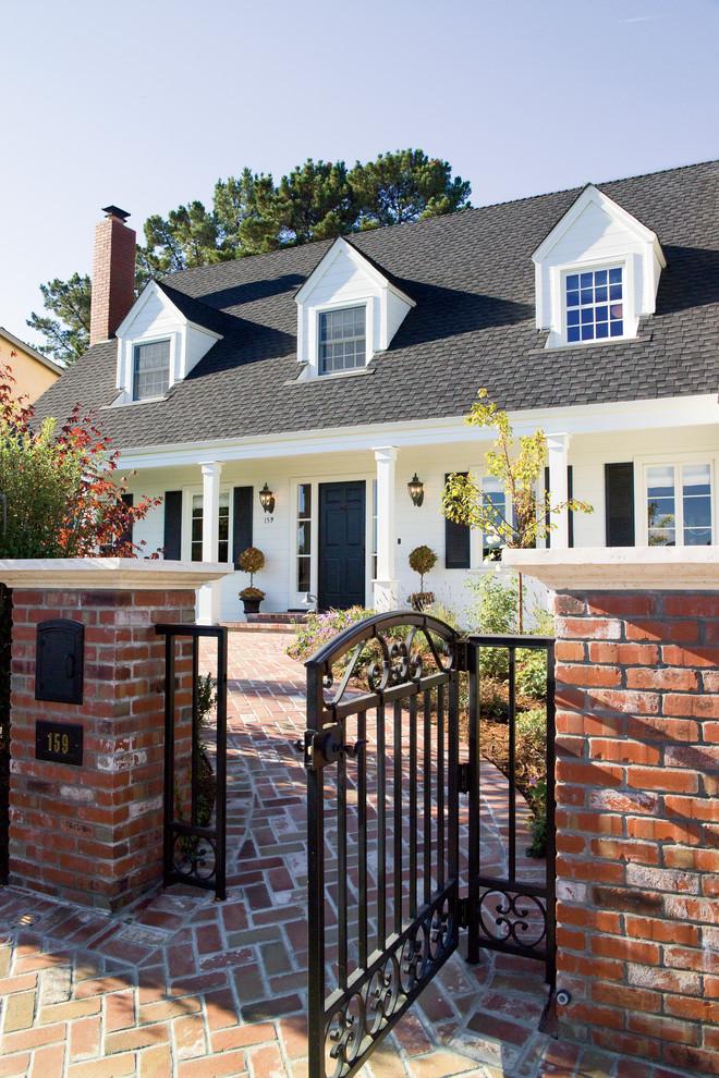luxury ranch house plans metal gate brick pavers white pillars light fixtures gable roofs column windows door traditional design