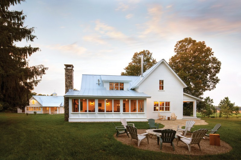 luxury ranch house plans white walls chimney patio chairs fire pit side wing windows farmhouse design