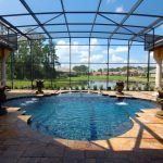 Minimalist Glass Pool Enclosure Idea Gold Toned Pavers For Floors Stone Made Water Fountains Luxurious Screened Pool