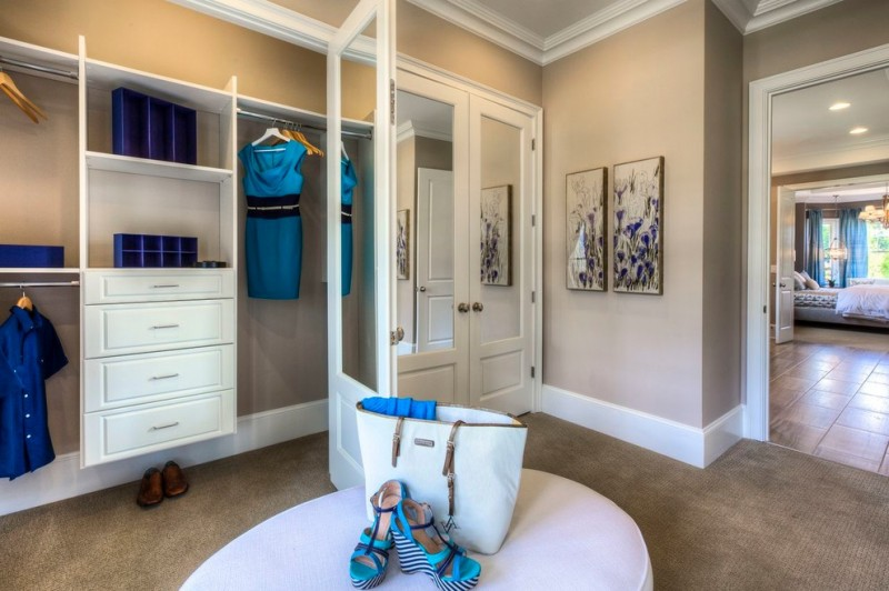 mirrored closet doors cream rug wall paint white painted cabinets wall art decoration marble tiles floor blue curtain pendant lamp