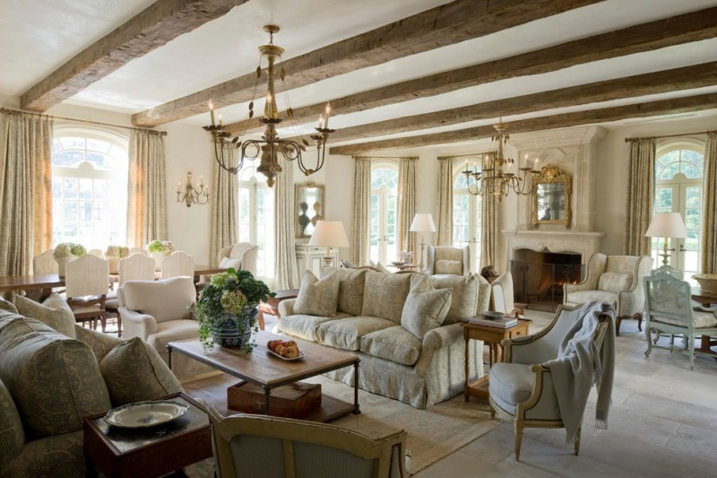 morning room furniture white sofa tall back chairs wooden tables standing lamps mirror chandeliers column ceiling limestone floors marble fireplace mediterranean design