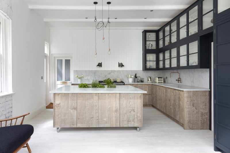 movable kitchen island with seating green plants faucet hanging lamps stove wall cabinets transitional room