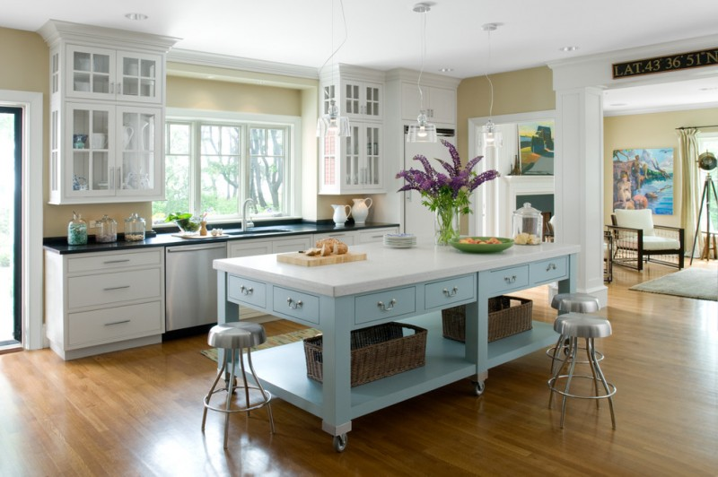 movable kitchen island with seating wood floor wall cabinets window purple flowers drawers stools sink faucet hanging lamps traditional room