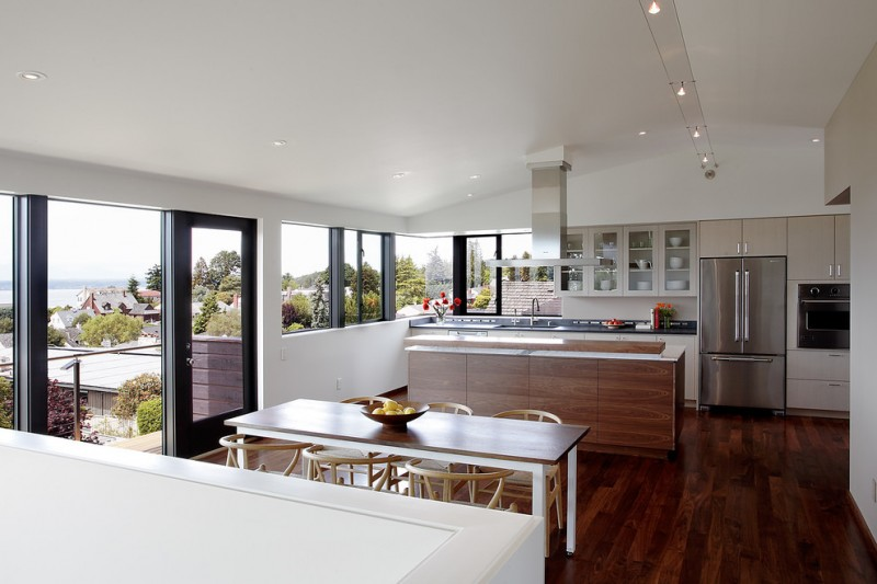 narrow dining room table hardwood floor ceiling lights chairs windows fridge cabinets