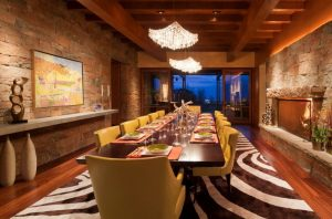 narrow dining room tables hardwood floor painting chandeliers chairs carpet southwestern style