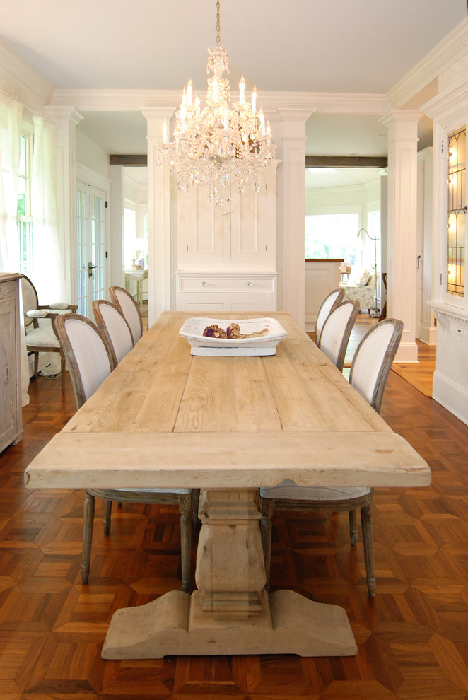 narrow dining room tables tall back chairs hardwood floors glass panels chandelier white walls cabinets shabby chic design