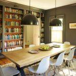 Narrow Dining Room Tables Wall Bookshelves Hardwood Floors Black Pendants Fur Carpet Low Back Chairs Windows Farmhouse Design