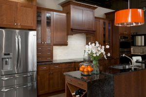 natural cherry kitchen cabinets quartz countertop cherry wide rail shaker orange chandelier marble countertop