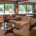 Oversized Couches Living Room Bookshelves Armchair Rug Window Walls Hardwood Floors Glasstop Table Lamp Throw Pillows Decorations Midcentury Design