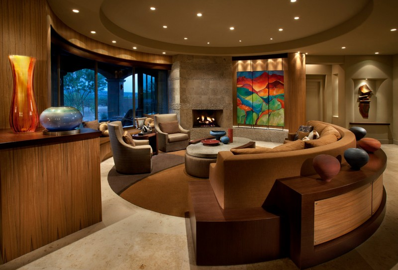 oversized couches living room ceiling lights armchairs window walls round ottoman storage marble floors contemporary design