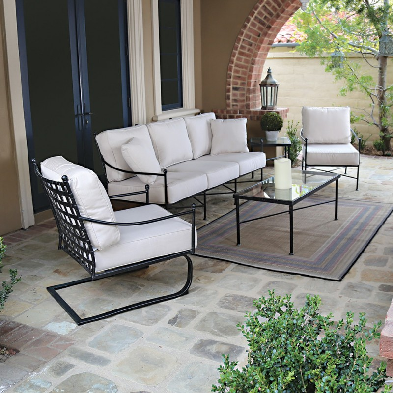 patio furniture seattle iron chairs cushioned chair glass table small rug candle and plant in vase decoration